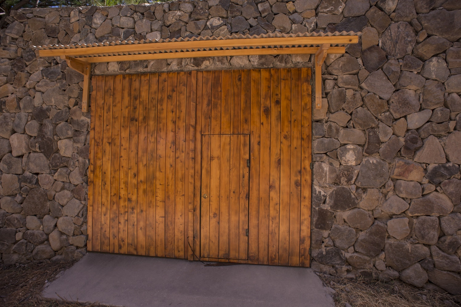 Wooden gate with stone wall