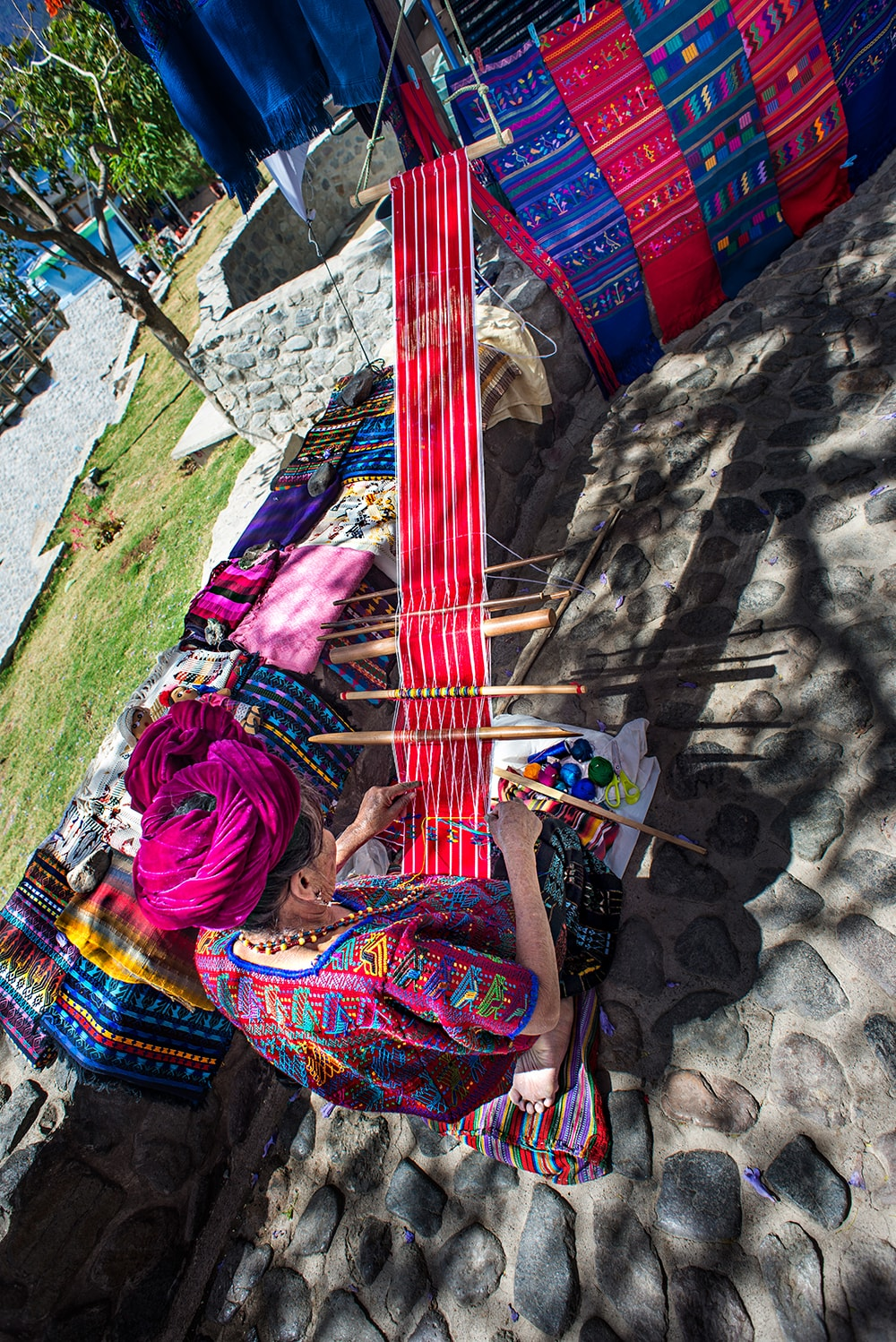 Mayan woman weaving textiles in Panajachel