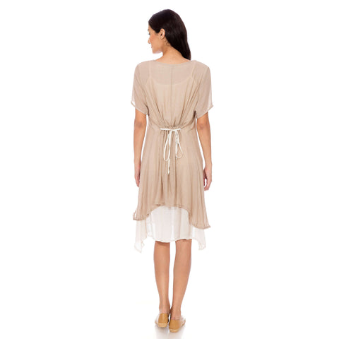 A dress with beige top and a cream inner attached.