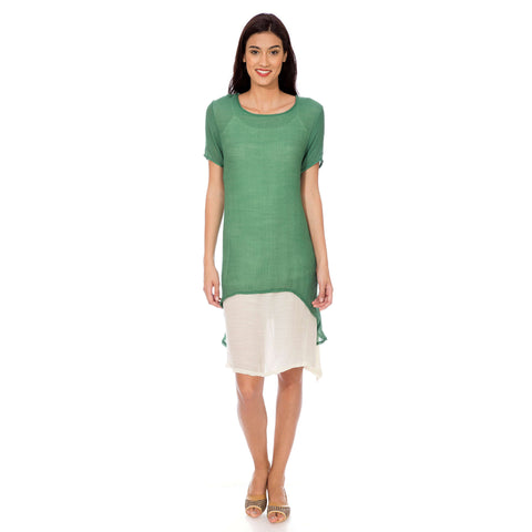 A dress with green top and a cream inner attached.