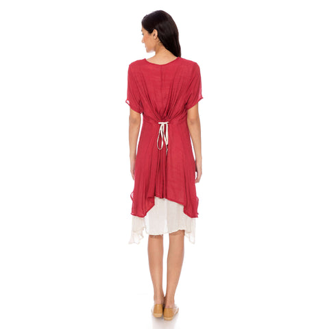 A dress with maroon top and a cream inner attached.