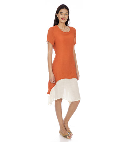 A dress with orange top and a cream inner attached.