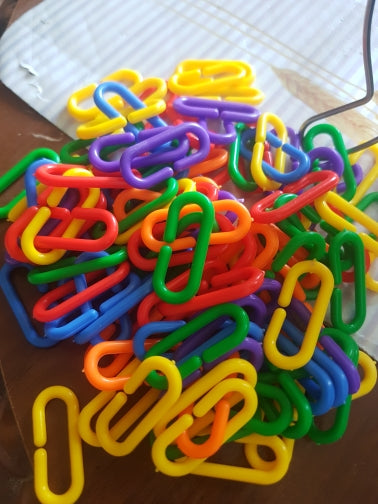 Pile of chain links bird toy