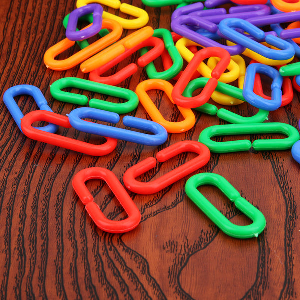 Colorful brid toy links on wooden table