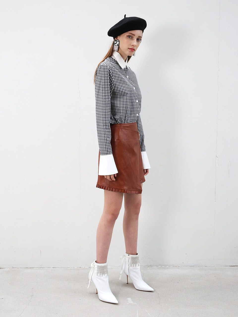 ROMY FAUX LEATHER WRAP MINI SKIRT