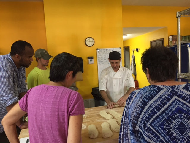 Troy DeRego demonstrating baguette shaping (photo by Becky Hagenston)