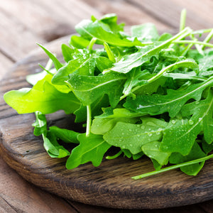 Arugula positioned on a cutting board