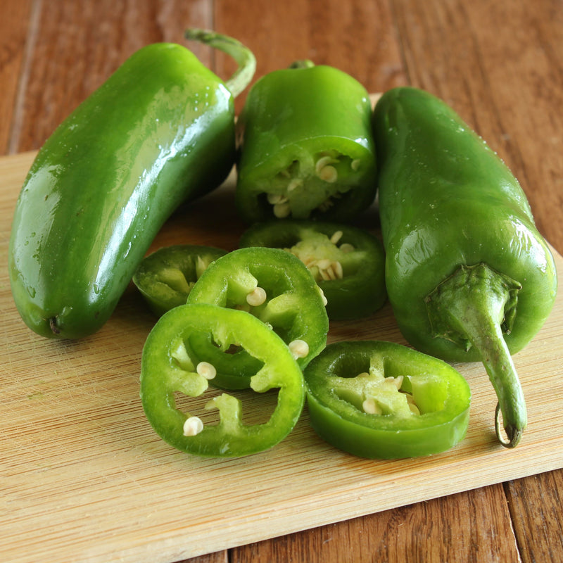 Jalapeno peppers on a cutting board