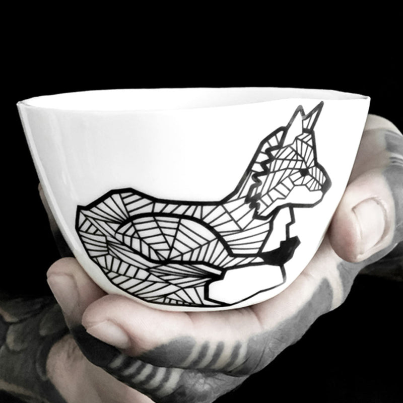 A porcelain cup decorated with a sitting fox