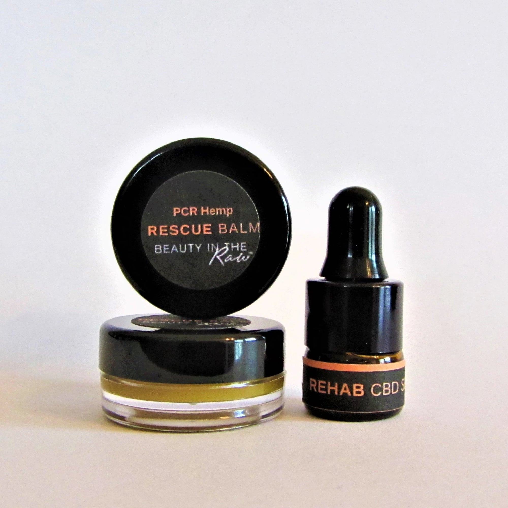 Mini CBD Skincare Discovery Set with trial sizes of Rehab CBD Serum and CBD-infused Rescue Balm showing balm detail