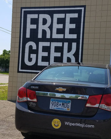 Wipermoji on vehicle in front of Free Geek sign
