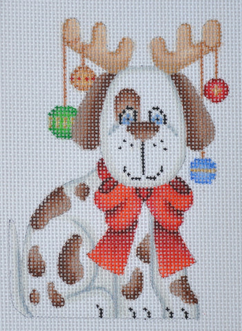 Christmas Ornament / Brown & White Spotted Dog with Red Bow