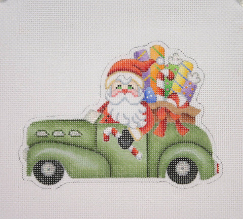 Christmas Ornament / Santa on the move in a Antique Car