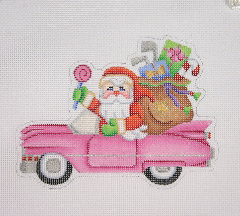 Christmas Ornament / Santa on the move in a Pink Cadillac