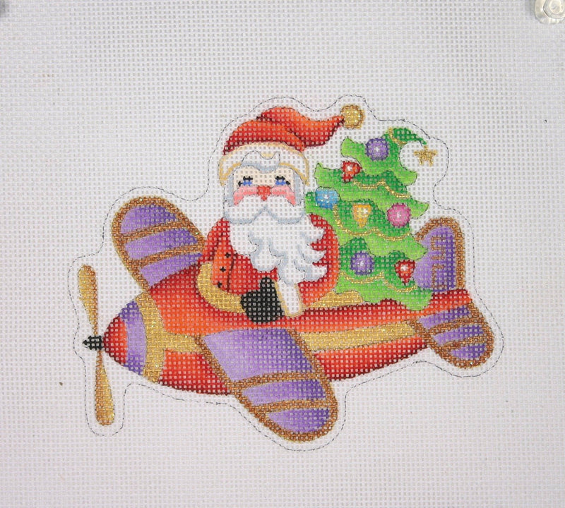 Christmas Ornament / Santa on the move in a Airplane