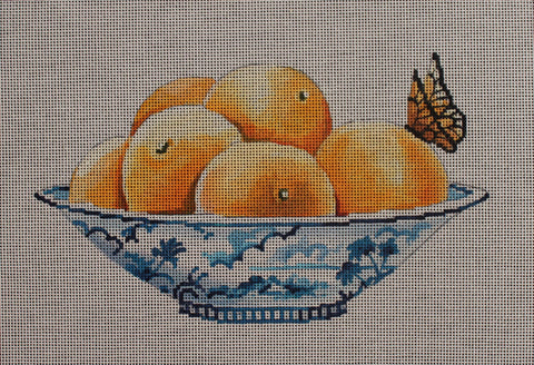 Oranges in blue vase