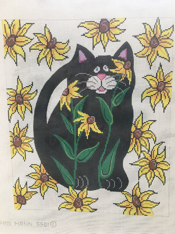 black cat in sunflowers