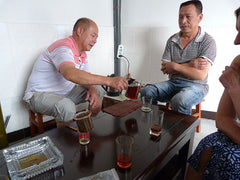 Drinking tea with factory owners