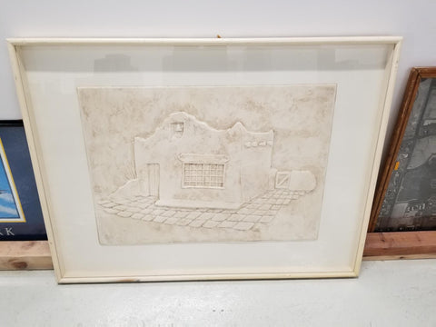 Raised picture of a pueblo in tan with white frame mat and beige frame