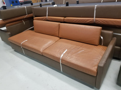 "dark brown 8' long, 33"" wide, 26"" tall couch with orange seats"