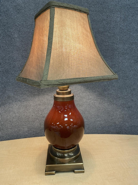 Shiny brown wood lamp with shade