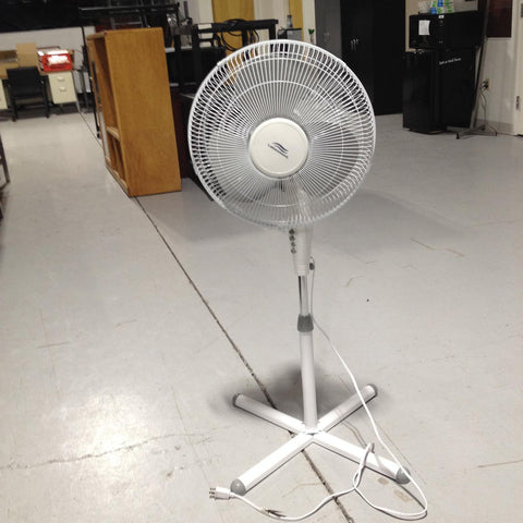 Stand-up. portable, rotating fan
