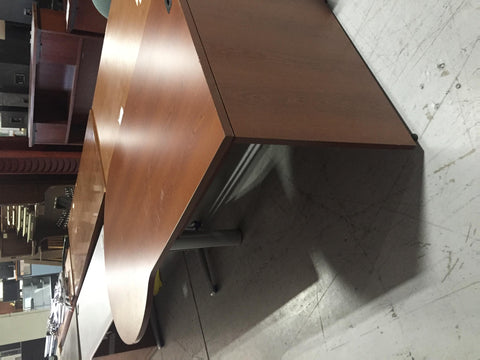 2 wood office desks located in office space 314