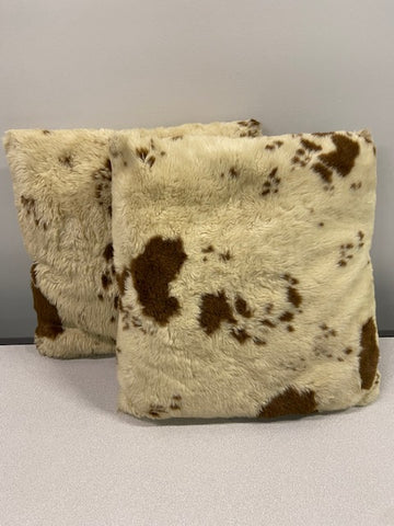Square, brown and white cow pattern pillows