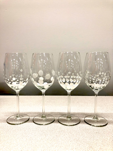 4 wine glasses with white bubbles painted on them
