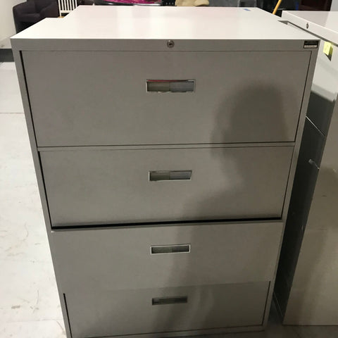 1 - four drawer vertical file cabinet