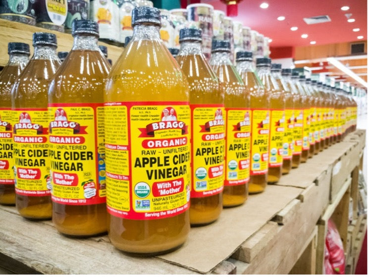 Top store-shelf featuring multiple rows of Apple Cider Vinegar on display