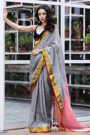 Soft Grey Textured Linen Saree With Gold Zari Border