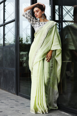 Light Mint Green Linen Saree With Zari Border