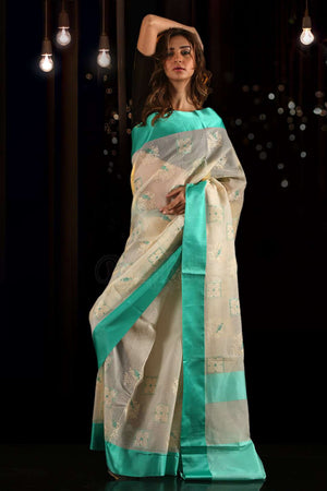 Off-White Blended Cotton Teal Embroidered Saree