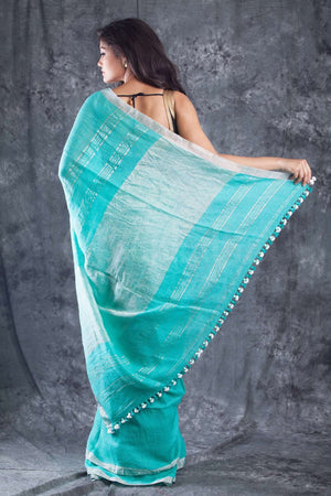 Sea Green Organic Linen Saree With Pompom & Silver Border Earthen Collection Roopkatha - A Story of Art