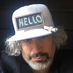 Chalkin' Social founder, David Schoonmaker, wearing the first prototype hat with HELLO written on it.