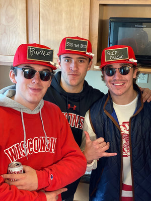 Luxe Red Chalkboard Hat being worn by college students