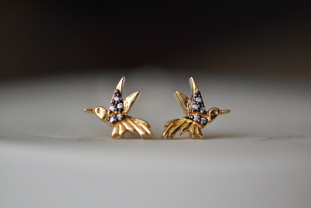Sorellina Hummingbird Motif Studs with 10 ten white diamonds, rhodium detail and on 18k yellow gold with post closure.