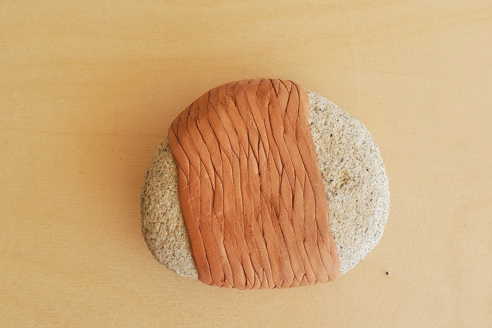 Load image into Gallery viewer, Braided Leather Wrapped River Rock Paperweight