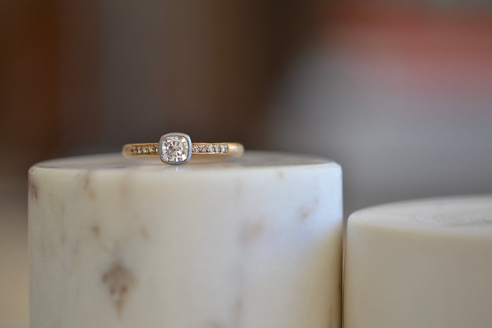 Load image into Gallery viewer, Malcolm Betts Cushion Cut Solitaire in Platinum and Rose Gold band shank .5ct .52ct 10 ten channel set white pave diamonds