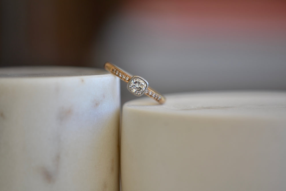 Malcolm Betts Cushion Cut Solitaire in Platinum and Rose Gold 10 ten channel set white pave diamonds
