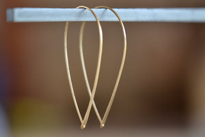 Carla Caruso Large Bow Hoop Hoops Earrings one tapered wire in 14k yellow gold with satin finish lock into other end