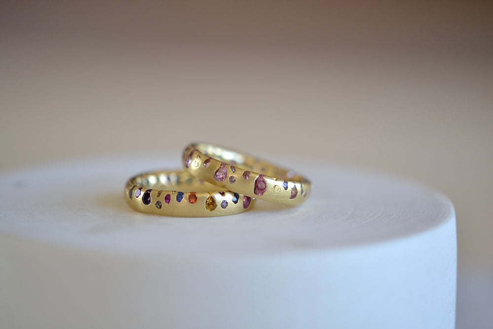 Polly Wales Soft Pink Confetti Band Ring in 18k recycled yellow gold with sapphires and cast not set and rainbow