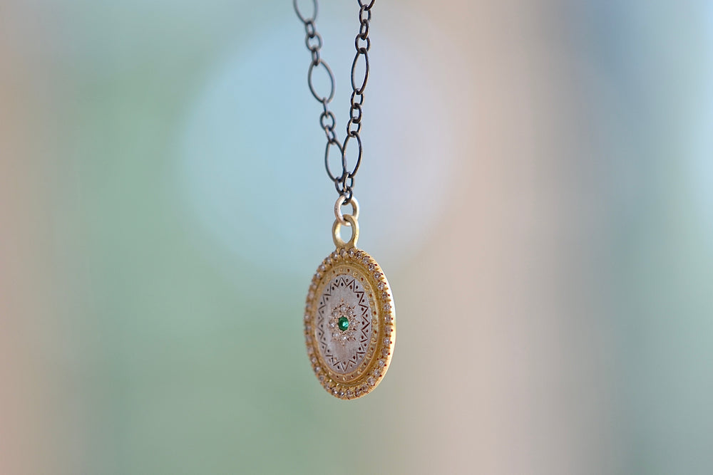 Adel Chefridi Emerald Flame Pendant 18k yellow gold and Sterling silver medallion chain with white diamonds emerald oxidized etching