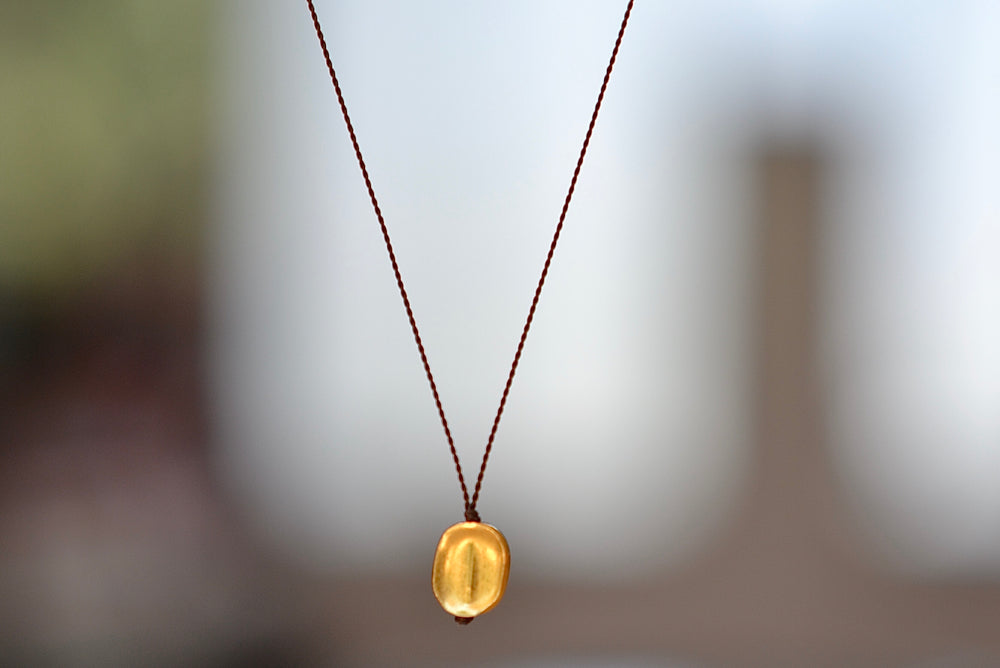 Load image into Gallery viewer, Margaret Solow 18k Gold Pendant Necklace Round Seed Bean Nylon Cord