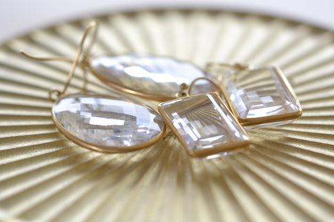 <small>Tej Kothari</small><br>Small Clear Faceted Quartz Egg Slice Earrings
