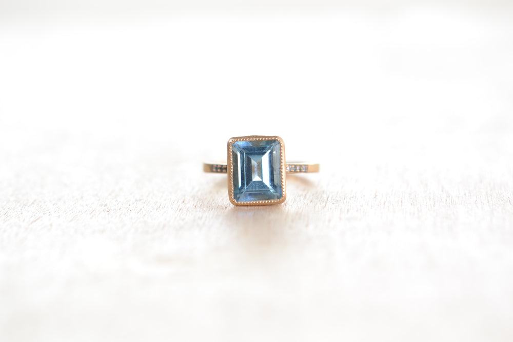 Jennifer Dawes Blockette Blue Topaz Cockail Bezel Set Engagement Ring 14k yellow gold pave emerald cut