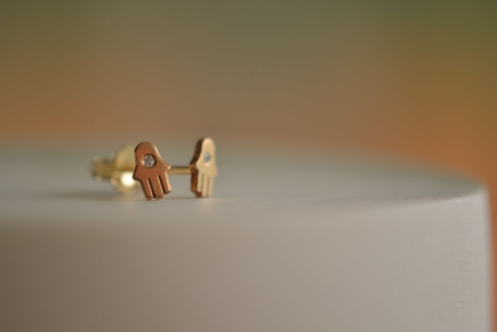 Zoe Chicco Itty Bitty One Diamond Stud Hamsa in 14k recycled yellow gold with post closure and sold as single earring