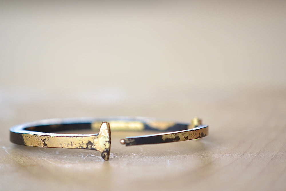 Load image into Gallery viewer, Pat Flynn Dust Nail Bracelet Blackened iron, 22k gold accents, 18k gold hinge