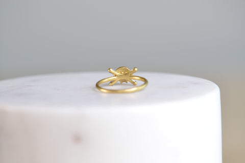 <small>Polly Wales</small><br>Small Skull Ring with Baguette Diamonds
